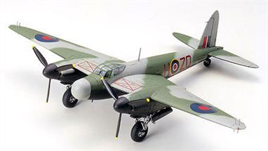 Construct a De Havilland Mosquito NF Mk.XIII/XVII with This 60765 1/72 Scale Plastic Model Kit by Tamiya. Engraved panel lines and moulded details create a realistic display. Highly detailed main landing gear. Fully detailed cockpit and instrument panel. Underwing drop tanks. Waterslide decals for the aircraft: NF Mk.XVII Fighter Interception Unit and NF Mk.XIII 410 Squadron. Brief history included. Detailed, illustrated assembly instructions.Glue and paints are required
