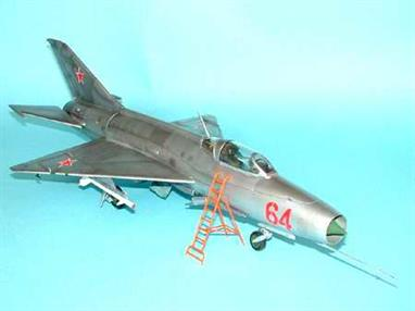 The MiG -21 F-13 was similar to the former version . It had a broader and lower fin and a different canopy. the armament also changed . The port NR-30 cannon was removed and the aircraft carried two underwing pylons with K-13 launch rails . The K-13 IR missile was identical to the first Sidewinders. The approx size of the model is fuselage 493mm, wingspan 225mm, landing gear and nose cone in metal, Requires polystyrene cement,super glue and paint to complete the model