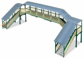With its fine scale latticework and curved section roof, this typical footbridge will add interest and a sense of importance to any model station.The versatile kit design means that the stairs can be assembled to face in either direction or straight off the end of the bridge. Additional kits can be used to create multiple spans, whilst larger, busier stations often had 2 stairways to each platform, leading off in both directions. Could also be used without the roof sections at a large terminus under an overall station canopy. Supplied with pre-coloured parts although painting and/or weathering can add realism; glue is required to complete this model. Span: 180mm