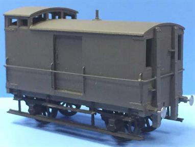 Model kit of a North Eastern Railway goods brake van with raised 'birdcage' lookout to allow the guard to observe signals.Long goods trains were often controlled with brakes being apploed on just the locomotive and guards' brake van. To ensure trains stopped when required it was essential for the guard to watch out for adverse signals and apply his brake to both stop the train and prevent it from running backwards.